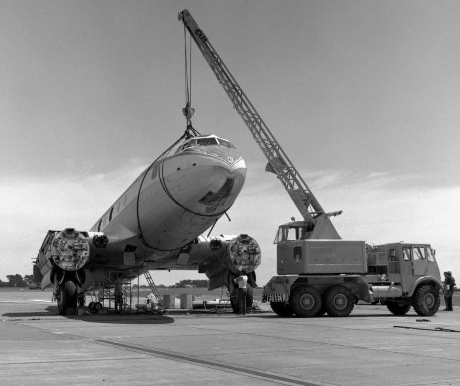 Battle of Hastings 1971. MoTaT staff and volunteers prepare to remove the front 22 feet of fuselage and nose section of Hastings NZ5801 at Ohakea in 1971 using the Coles crane Photo ref: OhG5271~70 ©RNZAF Official