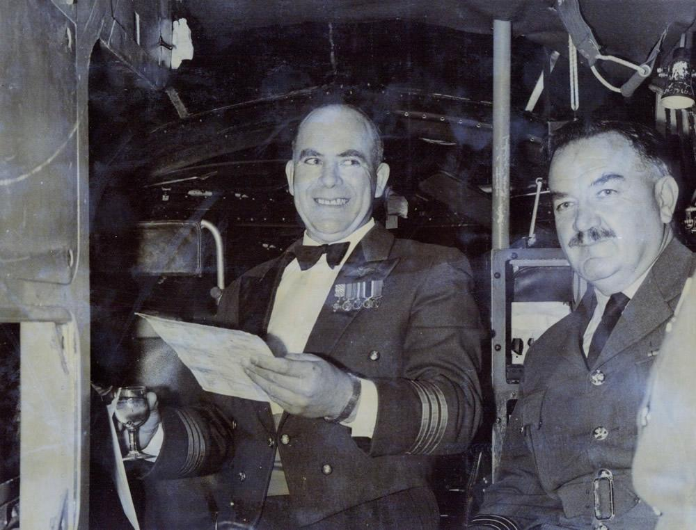 Drinks aboard Hastings CMK3 NZ5803 on the evening of 28th September 1967 – A farewell to Wg Cdr G.H.S. Tosland AFC and Bar, Base Commander RNZAF Ohakea, on his retirement from the RNZAF. Former fellow crew member and Hastings Wireless Operator, Wg Cdr A.G.E. 'Butch' Pugh, shares the moment – photo by RNZAF Ohakea via Jim Barclay
