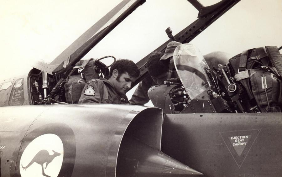 Flt Lt Jim Barclay strapping into the ejection set of 77 Squadron RAAF two-seater RAAF Mirage IIID A3-104, RAAF Base Darwin, Australia 1st June 1973