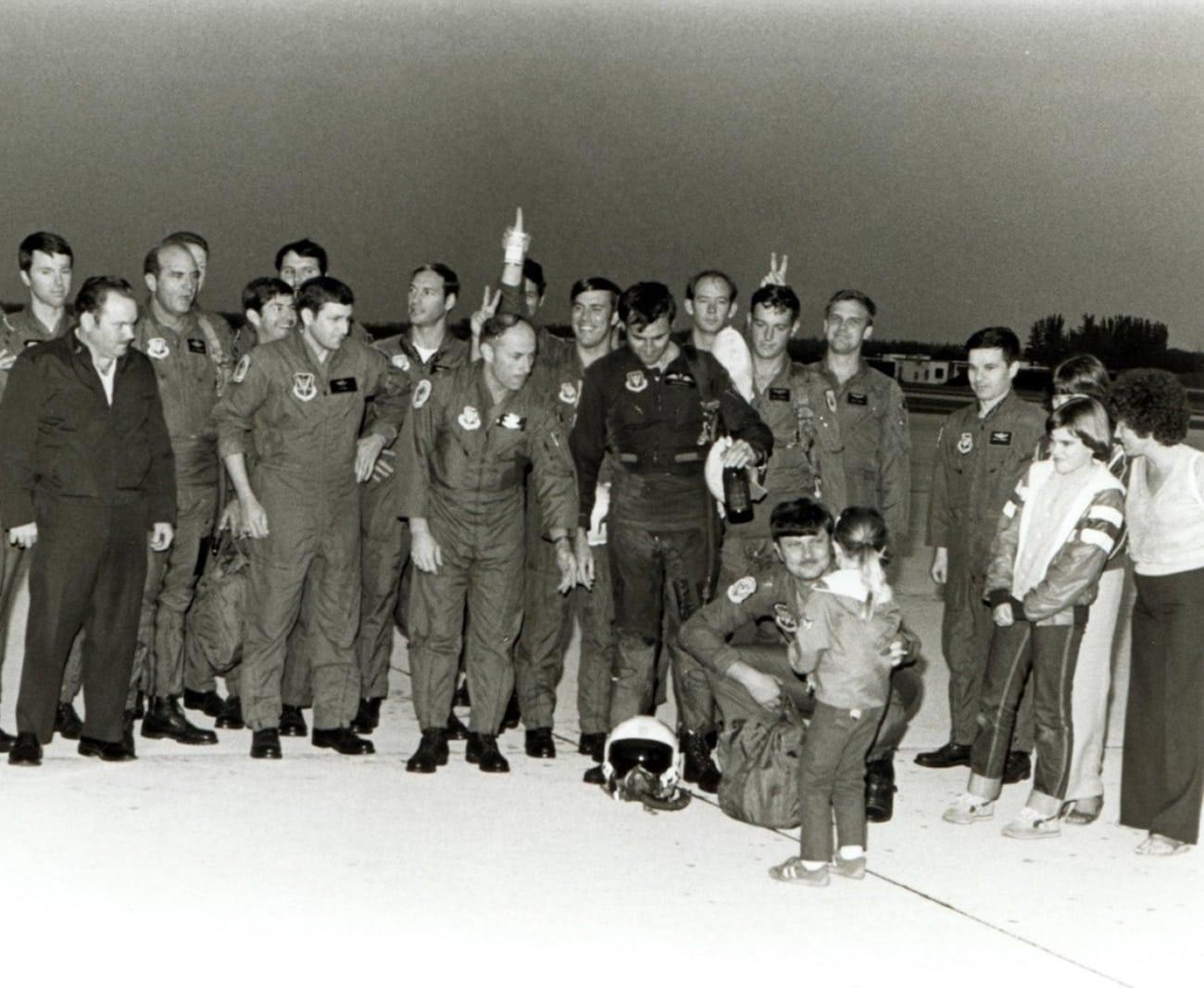 A doused Sqn Ldr Jim Barclay with 'champers' bottle and Joanie Barclay on right, daughters Nicola, Tracey and Steph (in lower front) and 308th TFTS aircrew after Jim's final F4 flight, Homestead AFB, Florida 26th January 1982