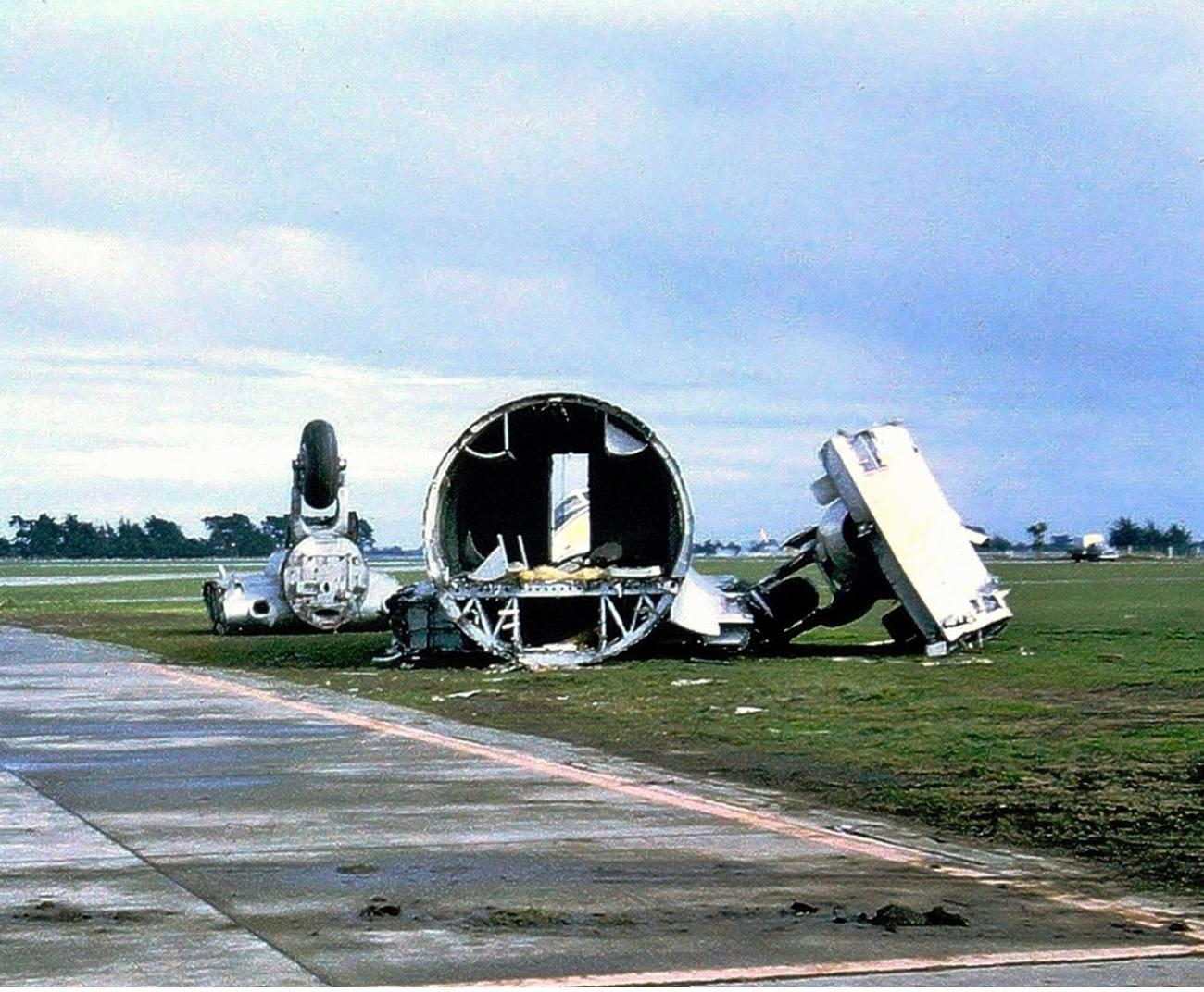 The remains of the fuselage centre section and severed main wheels of an RNZAF Hastings CMk3 – either NZ5802, or NZ5803. Some of the cockpit windows are just visible through the cockpit entry door as seen in the middle of the centre-fuselage section. Jim Barclay photo Ohakea July 1969